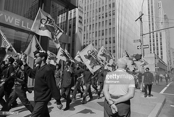 Banner carrying members of the militant Black Panther Party march here on 42nd Street en route to a scheduled news conference at United Nations Plaza...