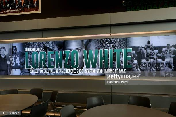 Banner congratulating former football player Lorenzo White's 'College Hall Of Fame' induction and Spartan Stadium 'Ring of Fame' is displayed in the...
