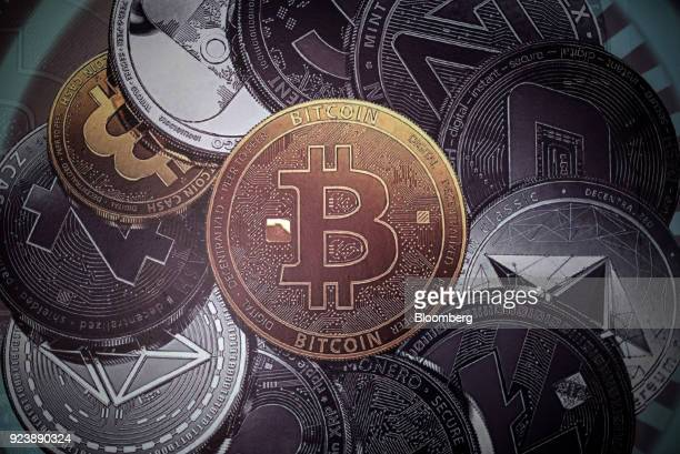 A banner depicting coins of various cryptocurrencies is displayed inside the cryptocurrency mining farm and school at the Ministry of Youth and...