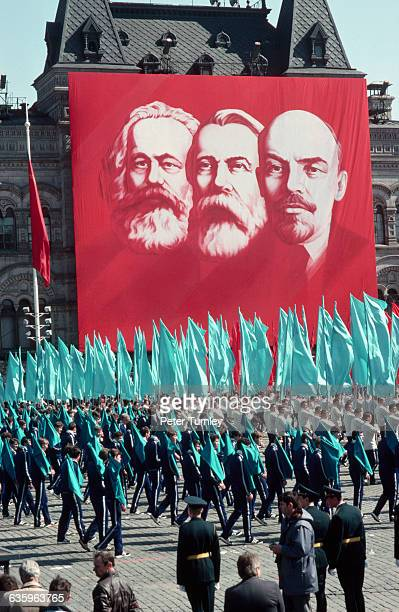 A banner depicting Marx Engels and Lenin celebrates the founding fathers of Communism