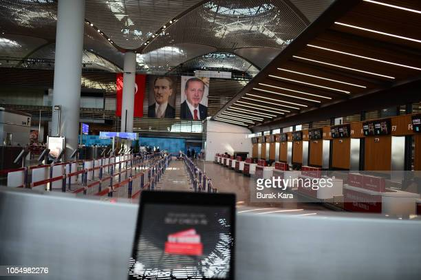 A banner depicting Mustafa Kemal Ataturk founder of modern Turkey and Turkish President Recep Tayyip Erdogan is seen at a terminal of the Istanbul...