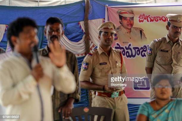 A banner featuring Rema Rajeshwari superintendent of police for the Indian Police Service is displayed at an event to raise awareness on fake news in...