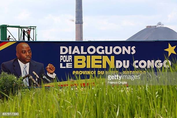 A banner featuring the President of Democratic Republic of Congo Joseph Kabila is seen in front of of a copper and cobalt mine on January 16 2017 in...