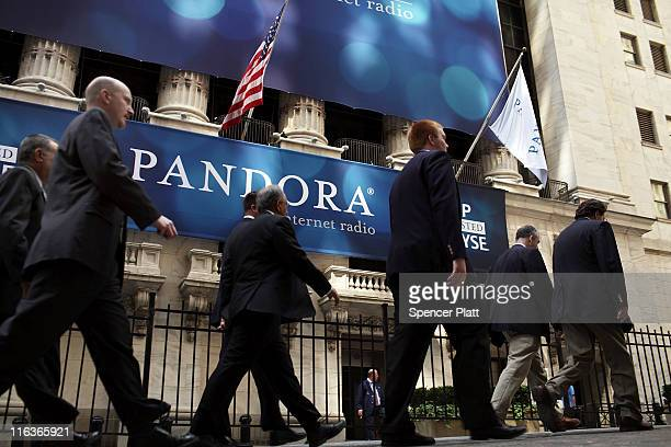 A banner for Pandora Media Inc the onlineradio company hangs in front of the New York Stock Exchange walk on its first day of trading as a public...