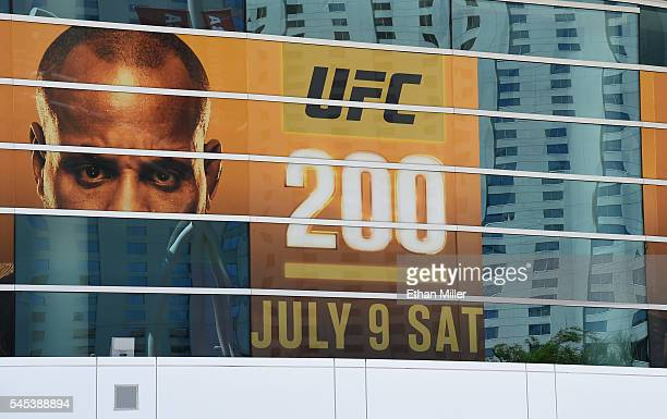 A banner for UFC 200 at TMobile Arena shows half of an image of mixed martial artist Daniel Cormier and a blank space where an image of mixed martial...