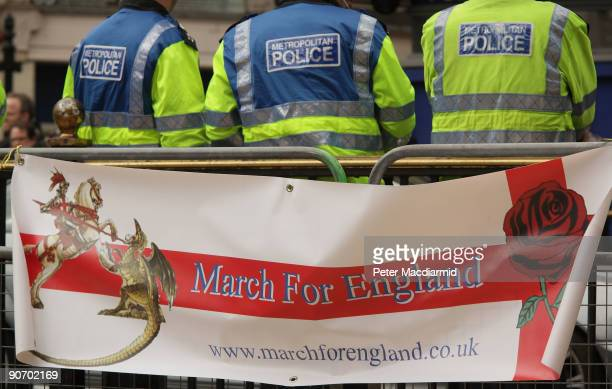 A banner from the March for England group is draped near police in Picadilly Circus on September 13 2009 in London England Large numbers of police...