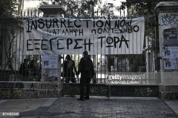 A banner hangs at the Athens Polytechnic building on November 15 after groups of antiauthoritarian youth occupied the building ahead of the 44th...