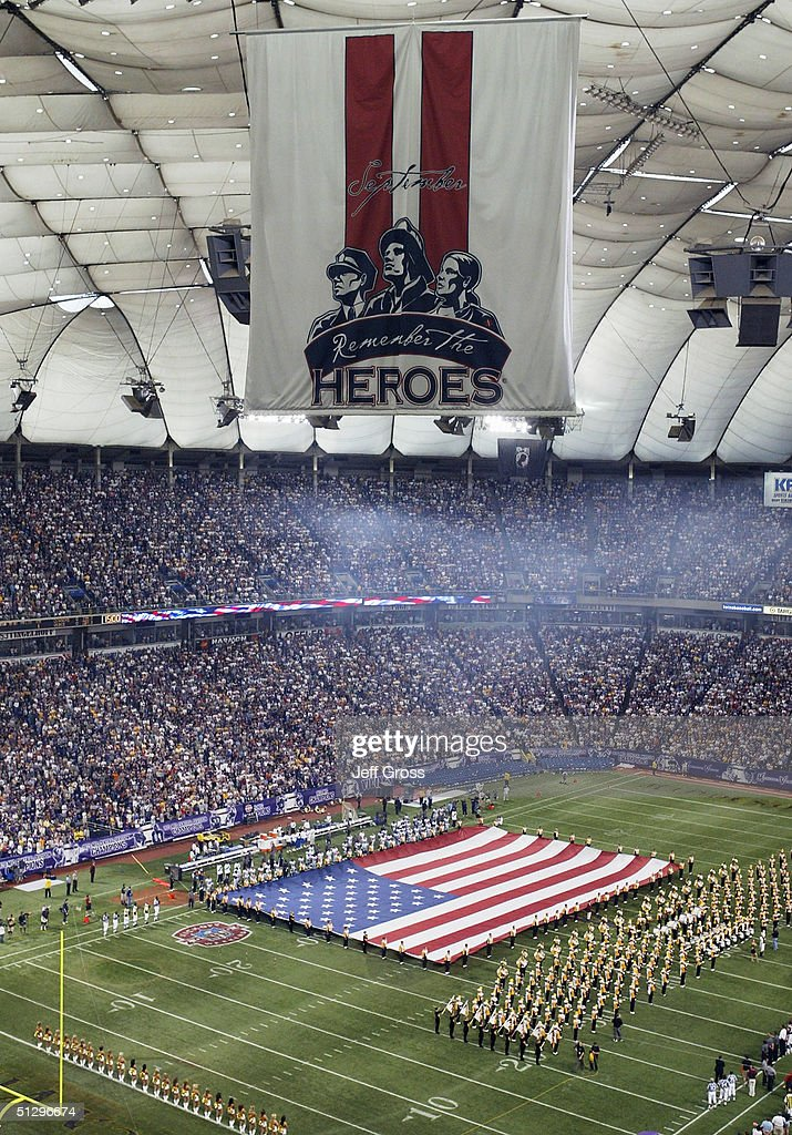 A 9/11 banner hangs from the ceiling as a flag is unveiled on the field prior to the start of the Minnesota Vikings and Dallas Cowboys game on September 12, 2004 at Hubert H. Humphrey Metrodome in Minneapolis, Minnesota. The Vikings won 35-17.