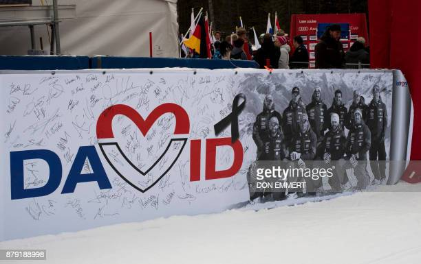 TOPSHOT A banner hangs in the finish area signed by racers in memory of French skier David Poisson during the FIS Ski World Cup Men's Downhill on...