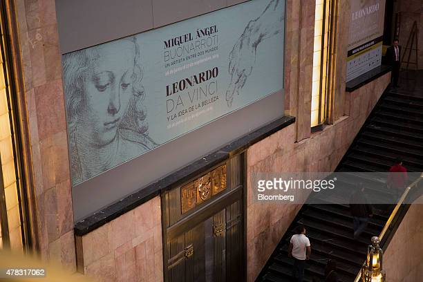 A banner hangs on a wall at the Palacio de Bellas Artes for expositions by Michelangelo Buonarroti and Leaonardo Da Vinci in Mexico City Mexico on...
