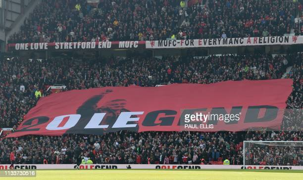 A banner honouring their newly appointed permanent manager Ole Gunnar Solskjaer is unfurled in the crowd during the English Premier League football...