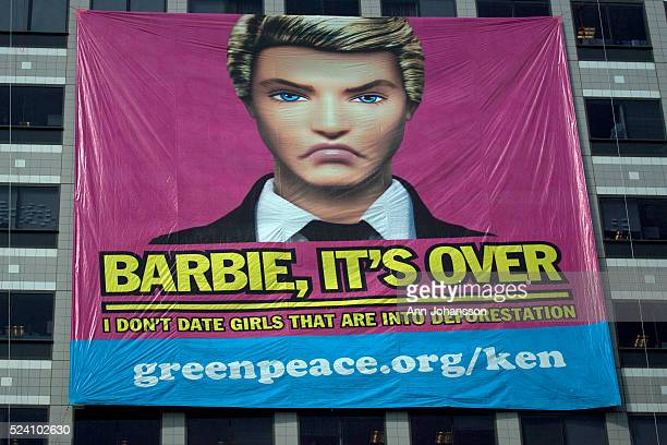 A banner hung by Greenpeace reads Barbie It's Over I don't date girls that are into deforestation at the Mattel headquarters in Los Angeles June 7...