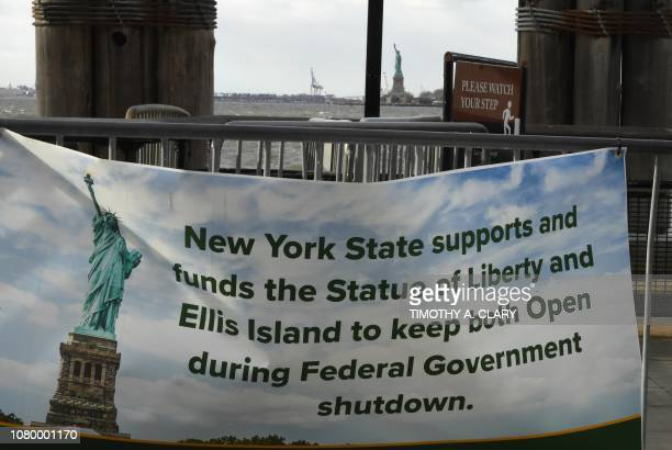 A banner in Battery Park on January 10 2019 New York Governor Andrew Cuomo has committed to paying $65000 a day to ensure the Statue of Liberty and...