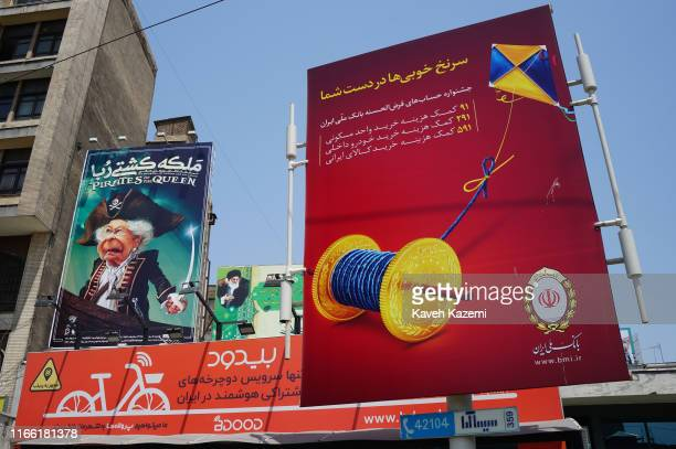 A banner in Ferdowsi Square depicts Queen Elizabeth as a sea pirate with a sword in her hand displayed next to another banner with image of Ayatollah...