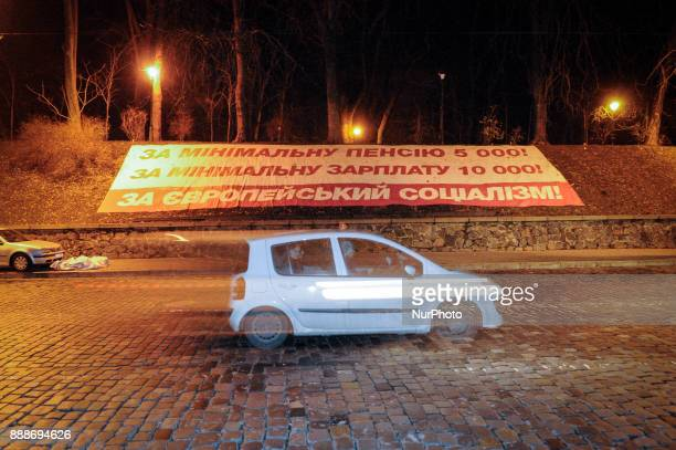 A banner in front of the Cabine of Ministers demanding higher pensions and higher minimum wages is seen in Kiev Ukraine on December 9 2017 The...