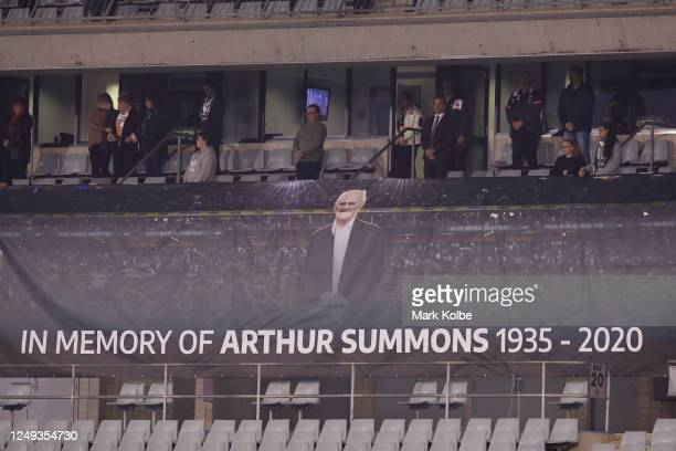 Banner in memory of Arthur Summons is seen during a moment in his honor before the round five NRL match between the Wests Tigers and the Canberra...