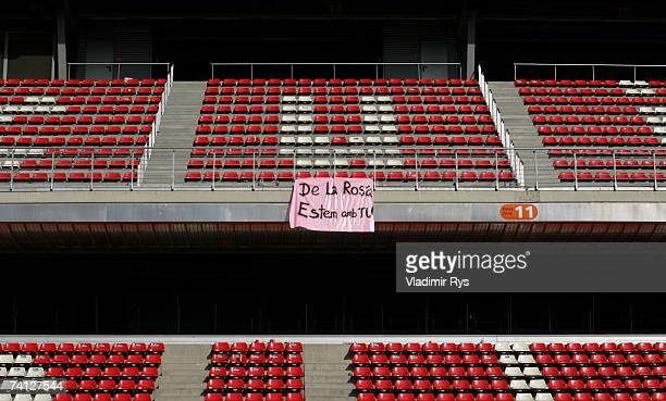 A banner in support of Pedro de la Rosa of Spain and McLaren Mercedes hangs on an empty grand stand after a practice for the Spanish Formula One...
