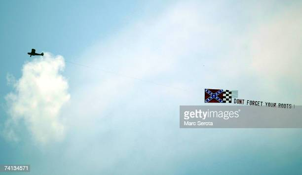 Banner incorporating the Confederate flag trails a small plane prior to a NASCAR Nextel Cup Series race May 12, 2007 at Darlington Raceway in...