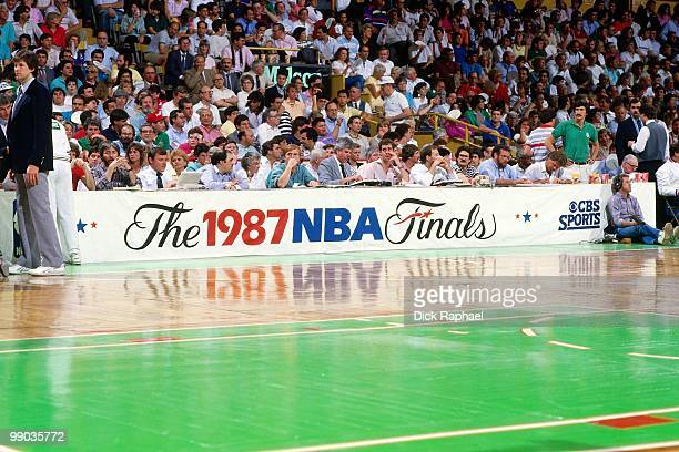 A banner is displayed at the scorers table during the 1987 NBA Finals between the Los Angeles Lakers and the Boston Celtics at the Boston Garden in...
