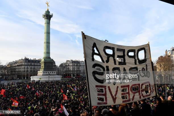 "Banner is displayed in front of the July Column reading ""Paris Opera on strike"" during a demonstration in Paris, on January 11 as part as a..."
