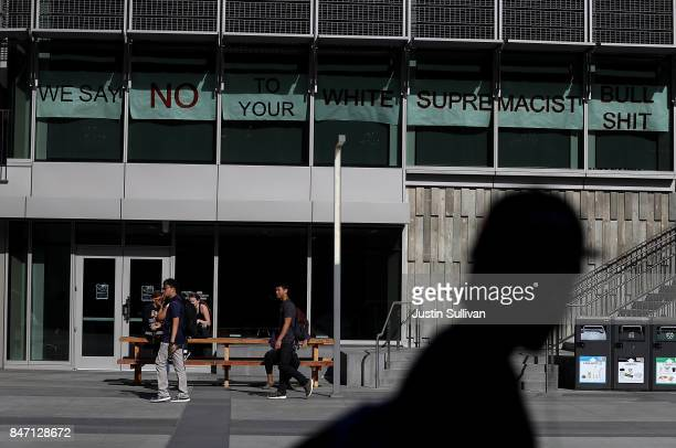 A banner is displayed in the window of a building across from Zellerbach Hall on the UC Berkeley campus on September 14 2017 in Berkeley California...