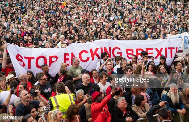 A banner is held up before Labour party leader Jeremy Corbyn speaks to crowd on the main stage at Labour Live White Hart Lane Tottenham on June 16...