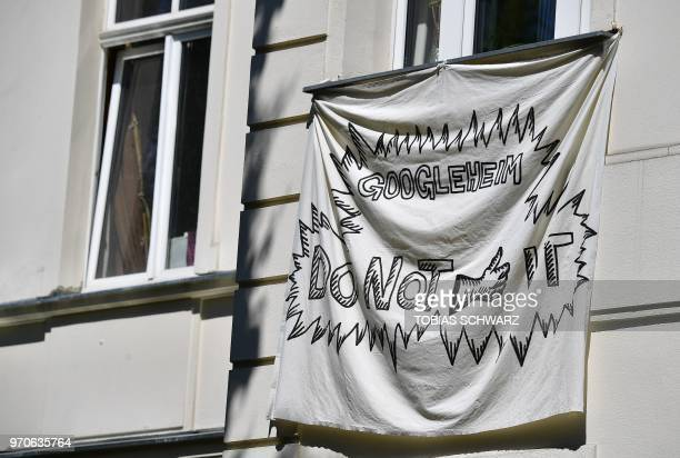 A banner is pictured at an appartement house in Berlin's Kreuzberg district on May 22 2018 Global cities from Seoul to Tel Aviv have welcomed Google...