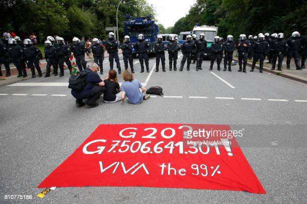 A banner is pictured during a demonstration against the G20 economic summit during a protest march on July 08 2017 in Hamburg Germany Hamburg is...