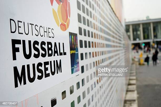 Banner is pictured in front of the construction site of the German Football Association football museum on April 4, 2014 in Dortmund, Germany. The...