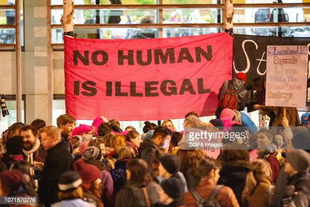 Banner is seen among protesters during the demonstration. Protestors gathered outside the Home Office in London to display their anger at the verdict...