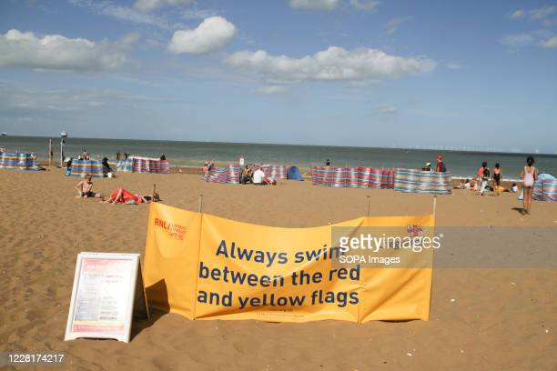 Banner is seen at the entrance of Joss Bay instructing people of the recommended place to swim at the bay.