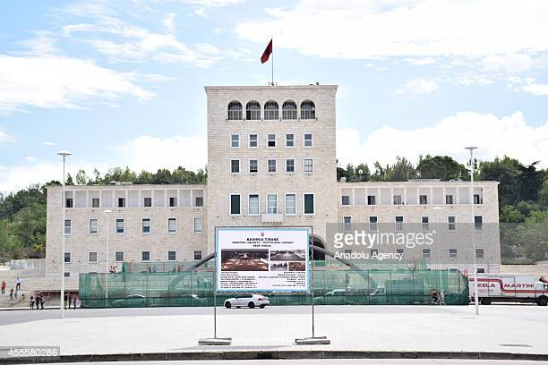 A banner is seen on a sidewalk as the preparations for Pope Francois' visit goes on in Tirana on September 17 2014 before Pope' Albania visit on...