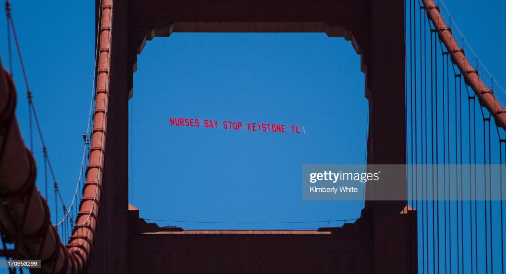 A banner is seen through a Golden Gate Bridge tower on June 20, 2013 in San Francisco, California. More than a thousand nurses and environmental activists protested against the XL Keystone pipeline construction and called on the Obama administration to reject the proposal.