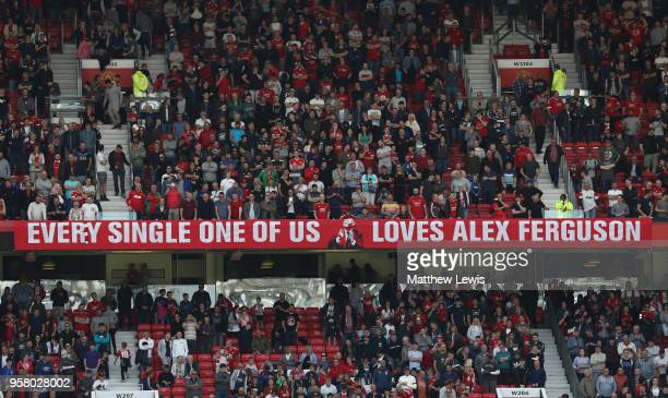 A banner is seen with a message for Sir Alex Ferguson during the Premier League match between Manchester United and Watford at Old Trafford on May 13...