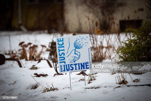 A banner is seen with the inscription Justice for Justine put by Justine Damond's neighbors in their lawns for her memory in Minneapolis Minnesota on...