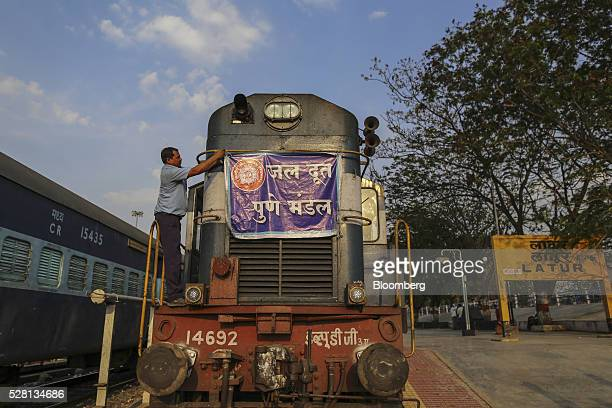 A banner is tied to the front of a train pulling water tankers at Latur railway station in Latur Maharashtra India on Saturday April 16 2016 Hundreds...