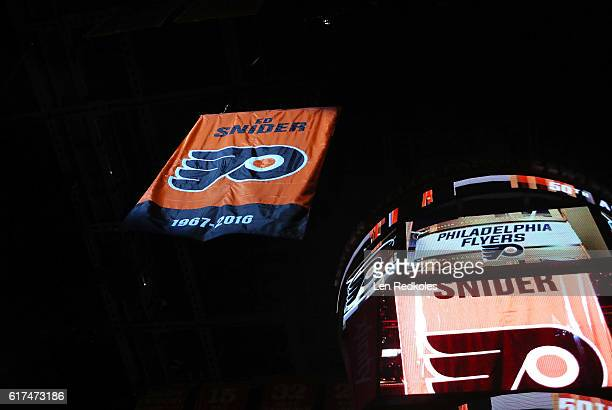 A banner is unfurled during a pregame ceremony honoring the late Ed Snider former chairman of Comcast Spectacor and owner of the Philadelphia Flyers...