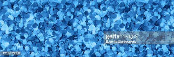 banner made from blue confetti isolated on white background. - happy tears film stock pictures, royalty-free photos & images