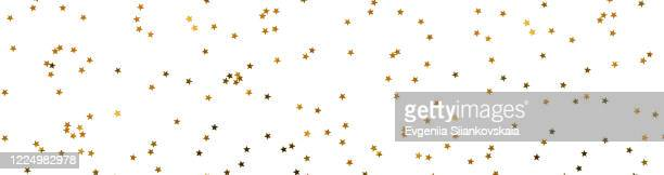 banner made from bunch of gold stars on white background. - confetti stock pictures, royalty-free photos & images