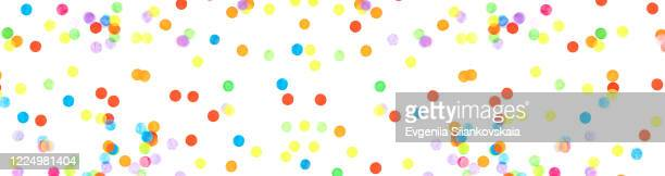 banner made from multicolored confetti isolated on white background. - happy tears film stock pictures, royalty-free photos & images