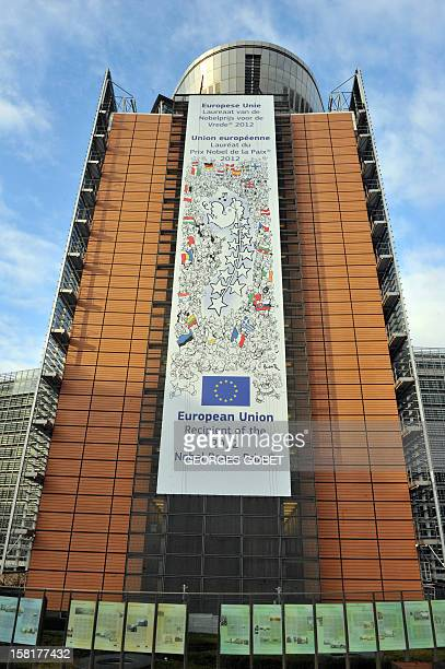 A banner marking the reception by European Union of this year's Nobel peace Prize is set on a facade of the European commission headquarters on...