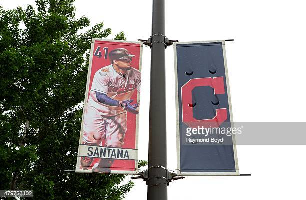 Banner of Cleveland Indians player Carlos Santana hangs outside Progressive Field, home of the Cleveland Indians baseball team on June 19, 2015 in...