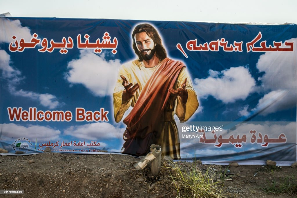 A banner of Jesus Christ welcomes home Catholic residents in the town of Karemles, Iraq on September 8, 2017.