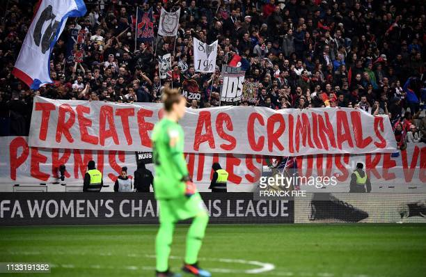 A banner of Paris SaintGermain's supporters reads treated as criminals during the UEFA Women's Champions League quarter final second Leg football...