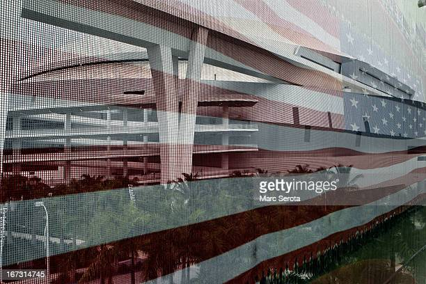A banner of the American Flag hangs over the parking garage at Marlins Park prior to the Washington Nationals taking on the Miami Marlins on April 15...