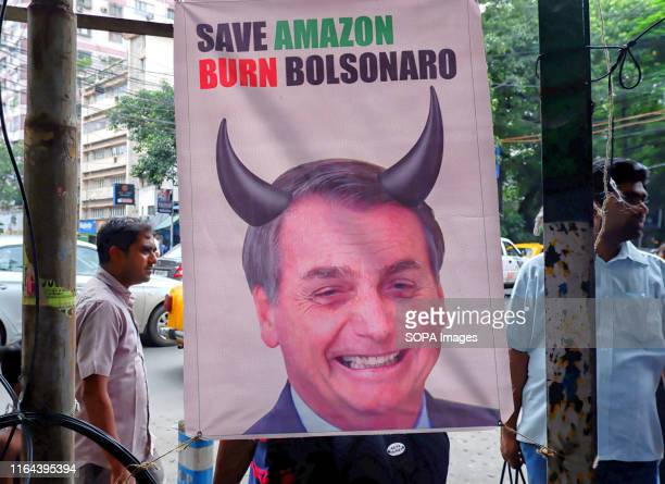 A banner of the Brazilian President Jair Bolsonaro hangs in front of the main road of Brazil Consulate during the protest Brazil's president Jair...