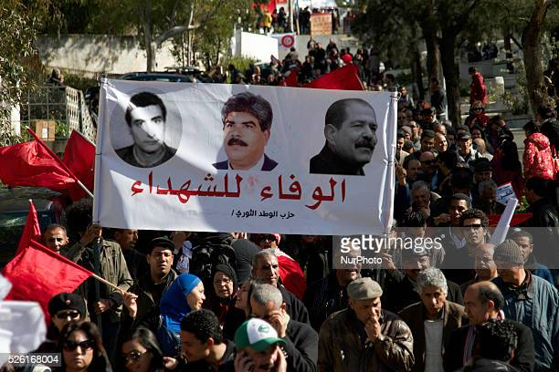 Banner of the Popular Front Martyrs Left Fadhel Sassi center Mohamed Brahmi and left Chokri Belaid On the occasion of the commemoration of the first...