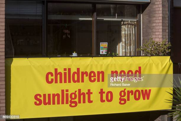 A banner on the balcony of a flat in Bowater House on the Golden Lane Estate protests about the 10storey luxury apartment development called The...
