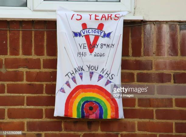 A banner outside a house during the commemoration The VE Day 75th anniversary when Victory in Europe over the Germans was announced during World War...