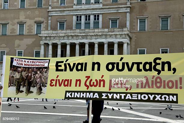 Banner outside the parliament that reads 'It is our pension our lives idiots ' set by pensioners during a protest march organized by General...